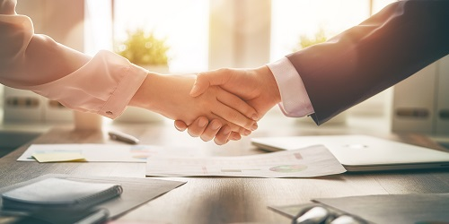 Photo of broker and carrier shaking hands for Employee Group Health Benefits