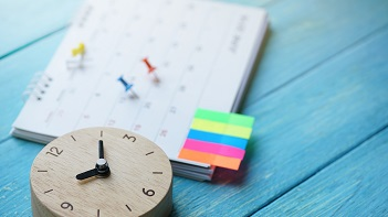 Calendar showing deadlines for employee benefits compliance.